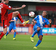 Leyton Orient striker Jay Simpsonand Crawley Town central defender Sonny Bradley compete for a high ball during the Sky Bet League 2 match between Crawley Town and Leyton Orient at the Checkatrade.com Stadium, Crawley, England on 10 October 2015. Photo by Bennett Dean.