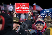 Attendees hold signs during a 'Make America Great Again' rally in Duluth, Minnesota, U.S. on Wednesday, Sept. 30, 2020. Trump and Democratic nominee Joe Biden began their first debate on an acrimonious note and quickly made it personal, with each candidate interrupting and talking over each other. Photographer: Ben Brewer/Bloomberg