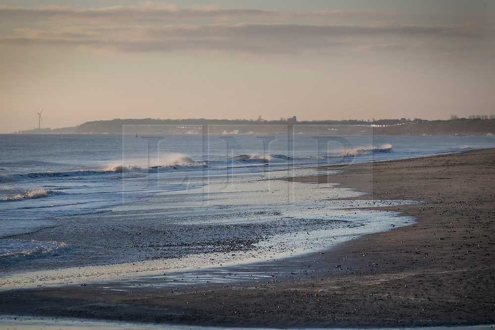 © Licensed to London News Pictures. 14/01/2017. Great Yarmouth, UK. First light on a calm day in Gorleston-on-Sea. Hundreds of people are returning to their homes after flood warnings. A change in the wind direction stopped any major flooding to properties on the east coast of England.  Photo credit: Peter Macdiarmid/LNP