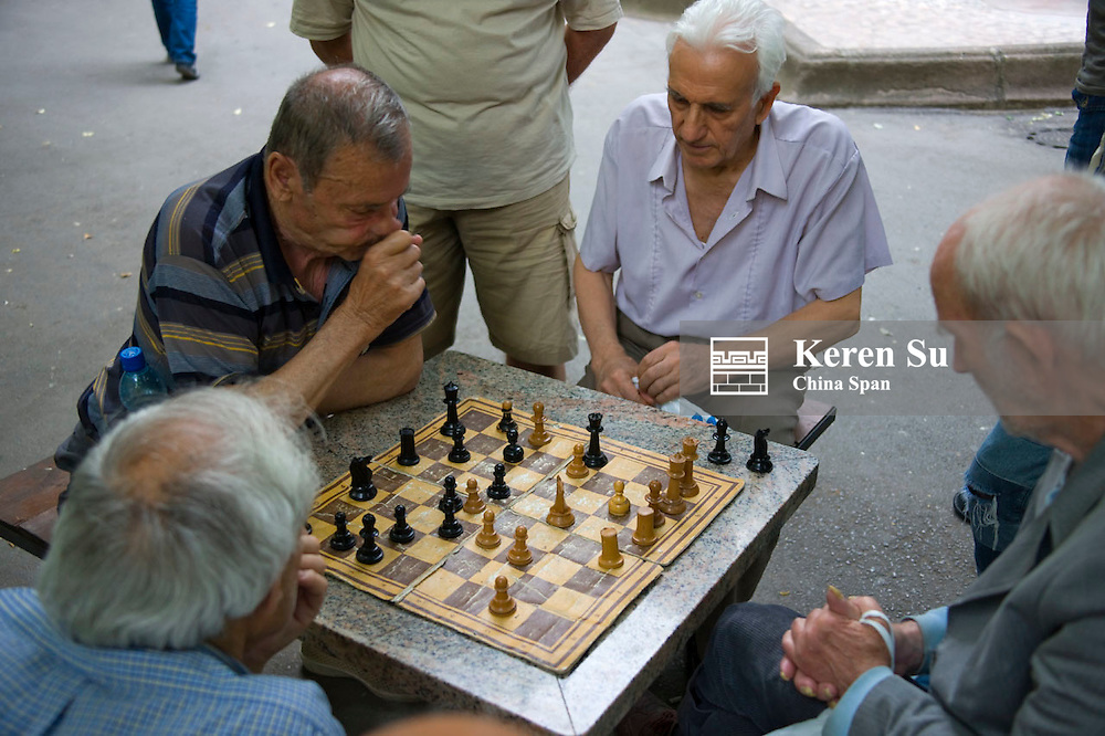 Old people playing chess in the park, Plovdiv, Bulgaria