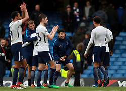 Tottenham Hotspur's Son Heung-Min (centre) and Dele Alli (right) celebrate after the game