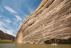 North America, United States, Utah, Dinosaur National Monument, Green River, raft under canyon walls at Echo Park