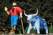 Paul Bunyan and his ox Babe statue at the Trees of Mystery roadside attraction, Klamath, California