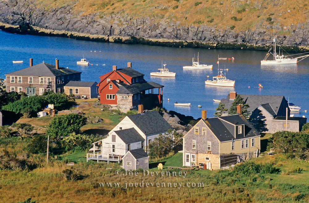 Houses on the coast and boats in the harbor. Monhegan Island, Maine