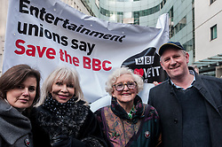 © Licensed to London News Pictures. 23/11/2015. LONDON, UK. (L to R) Former Doctor Who girls, Sophie Aldred and Katy Manning, June Hudson (inventor of Doctor Who's iconic long scarf) and former Doctor Who, Peter Davison, gathered outside Broadcasting House in central London to oppose the threat of 20% government cuts to the Corporation which has brought shows such as Dr Who since 1922. Photo credit : Stephen Chung/LNP