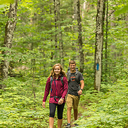Teenagers hike on the Loop Trail next to Deboullie Pond in Aroostook County, Maine. Deboullie Public Reserve Land.