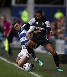 Queens Park Rangers' Ryan Manning, (left) battles for possession of the ball wih Norwich City's Josh Murphy, (right)