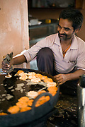 A man making jalebis on a stall in the backstreets of a Jaipur bazaar, Jaipur, India