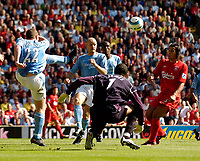 """Fotball<br /> Foto: SBI/Digitalsport<br /> NORWAY ONLY<br /> <br /> Liverpool v Manchester City<br /> Barclays Premiership, 21/08/2004.<br /> <br /> Manchester City's Richard Dunne (L) comes to the rescue for City as David """"Calamity"""" James fumbles a ball in the penalty area."""