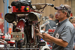 Doug Jones of Georgia makes repairs to his 1914 Indian at Triple S Harley-Davidson who opened their shop after the finishline stop in Morgantown WV for the riders and crews to make repairs during the Motorcycle Cannonball Race of the Century. Stage-2 from York, PA to Morgantown, WV. USA. Sunday September 11, 2016. Photography ©2016 Michael Lichter.