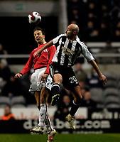 Photo: Jed Wee/Sportsbeat Images.<br /> Newcastle United v AZ Alkmaar. UEFA Cup. 08/03/2007.<br /> <br /> Alkmaar's Barry Opdam (L) jumps with Newcastle's Antoine Sibierski.