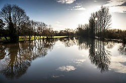 © Licensed to London News Pictures. 23/12/2019. Yalding, UK. The River Beult remains in flood near Yalding, Kent.  Flood levels have begun to recede in the centre of the village. River levels are beginning to drop after days of heavy rain in the south. Photo credit: Peter Macdiarmid/LNP