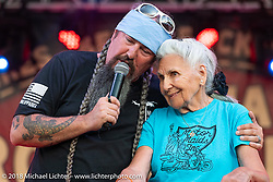 Nonagenarian Gloria Struck on the main stage of the Laconia Roadhouse with Jack Schit during Laconia Motorcycle Week. NH, USA. Saturday, June 16, 2018. Photography ©2018 Michael Lichter.