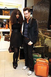 Model JOY VIELI and designer PERCY PARKER at the MCM Christmas party held at their store at 5 Sloane Street, London on 26th November 2008.