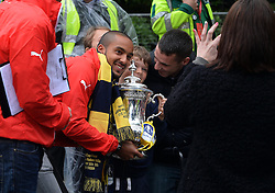 © Licensed to London News Pictures. 31/05/2015. <br /> LONDON, UK. The Arsenal FC first team and manager Arsene Wenger parade the FA Cup trophy through the streets of North London in an open top bus to celebrate winning the FA Cup yesterday. Theo Walcott.  London, Sunday 31 May 2015. Photo credit : Hannah McKay/LNP