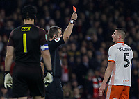 Football - 2018 / 2019 EFL Carabao (League) Cup - Fourth Round: Arsenal vs. Blackpool<br /> <br /> The night ends in disappointment for Paudie O'Connor (Blackpool FC) as he looks upto the red card brandished by Referee David Coote at The Emirates.<br /> <br /> COLORSPORT/DANIEL BEARHAM
