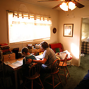 Jeanne spends a little extra time with Trevor in the bedroom they converted into the classroom.