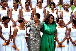 338<br /> 15.01.2012<br /> Oprah Winfrey and Nelson Mandela's wife Graca Machel, poses for a picture with class 2012 girls after the Inaugural graduation of the Oprah Winfrey leadership Academy for girls class 2011, Henley on klip, Meyerton.<br /> Picture:Itumeleng English