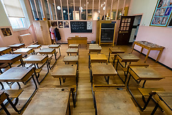 Old fashioned classroom inside Scotland Street School , designed by Charles Rennie Mackintosh, in Glasgow, Scotland, United Kingdom