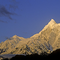 CHINA, TIBET, Himalaya.  Sunrise on Mount  Gyala Peri (7150m), one of highest peaks in the eastern Himalaya.