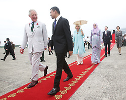 The Prince of Wales (left) and the Duchess of Cornwall are accompanied by His Royal Highness Prince Haji Al-Muhtadee Billah, the Crown Prince of Brunei, and his wife Sarah (behind, third right), Crown Princess of Brunei upon arriving in Brunei during an 11-day autumn tour of Asia.