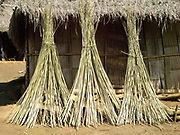 After harvesting, hemp (cannabis sativa) is left to dry in the sun for around 7 days before the bark is peeled off in long thin lengths. Making hemp fabric is a long and laborious process; the end result is a strong durable cloth with qualities similar to linen which the Hmong women use to make their traditional clothing. In Lao PDR, hemp is now only cultivated in remote mountainous areas of the north.