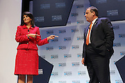 Republican presidential candidate Gov. Chris Christie listens to a comment by SC Gov. Nikki Haley at the Heritage Foundation Take Back America candidate forum September 18, 2015 in Greenville, South Carolina. The event features 11 presidential candidates but Trump unexpectedly cancelled at the last minute.