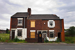 Boarded up, derelict and empty property, Hanley, Staffordshire, England, UK.