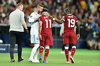 KIEV, UKRAINE - MAY 26: Sergio Ramos of Real Madrid console Mohamed Salah of Liverpool during the UEFA Champions League final between Real Madrid and Liverpool at NSC Olimpiyskiy Stadium on May 26, 2018 in Kiev, Ukraine. (MB Media)