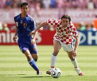 Photo: Chris Ratcliffe.<br /> Japan v Croatia. Group F, FIFA World Cup 2006. 18/06/2006.<br /> Darijo Srna of Croatia clashes with Mitsuo Ogasawara of Japan.