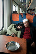 An ethnic Hui couple sleep on the Lhasa-Beijing Express, the world's highest train route.