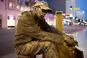 Gregory is a 49 year old living statue, spraypainted in gold, living and performing on Hollywood Boulevard. Originally from Philadelphia he wandered through the States and claims he just arrived from San Diego. According to Spiderman though, another street performer, he has been on Hollywood Boulevard for as long as he can remember. Gregory dreams of becoming famous and one day travel the world. COPYRIGHT JURRIAAN BROBBEL