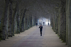 © Licensed to London News Pictures. 17/01/2021. London, UK. The parks are very busy, but The Mall, in central London, remains quiet this morning with only a few joggers and cyclists to be seen. Foreign Secretary Dominic Raab has said that every adult in the UK will be offered a first dose of a coronavirus vaccine by September. Photo credit: Peter Macdiarmid/LNP