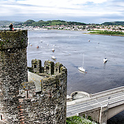 Kate Coleman Conwy Castle is a medieval castle built by Edward I in the late 13th century. It forms part of a walled town of Conwy and occupies a strategic point on the River Conwy. It is listed as a World Heritage Site.
