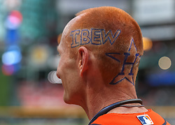 April 30, 2018 - Houston, TX, U.S. - HOUSTON, TX - APRIL 30:  John Easton Jr. of the International Brotherhood of Electrical Workers sports his Astros appreciation on his shaved head during the baseball game between the New York Yankees and Houston Astros on April 30, 2018 at Minute Maid Park in Houston, Texas.  (Photo by Leslie Plaza Johnson/Icon Sportswire) (Credit Image: © Leslie Plaza Johnson/Icon SMI via ZUMA Press)