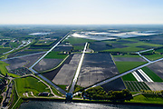 Nederland, Noord-Holland, Medemblik, 07-05-2018; Wieringermeerpolder met gemaal De Lely, een van de twee gemalen verantwoordelijk voor het droogmalen van de Wieringermeer; architect Dirk Roosenburg. Kassen Agriport A7 in de achtergrond.<br /> Wieringermeer polder with pumping station De Lely, one of the two pumping stations responsible for the draining of the Wieringermeer.<br /> <br /> <br /> luchtfoto (toeslag op standard tarieven);<br /> aerial photo (additional fee required);<br /> copyright foto/photo Siebe Swart