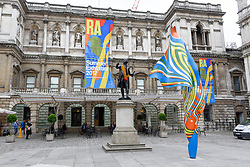 "© Licensed to London News Pictures. 08/06/2017. London, UK. A 6m high sculpture caled ""Wind Sculpture VI"" by Yinka Shonibare RA greets visitors to the Summer Exhibition 2017 at the Royal Academy of Arts in Piccadilly.  Co-ordinated by Royal Academician Eileen Cooper, the 249th Summer Exhibition is the world's largest open submission exhibition with around 1,100 works on display by high profile and up and coming artists.<br />  Photo credit : Stephen Chung/LNP"