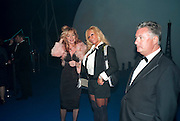 FATIMA BARBOSA; JULIE PATSALIDES, Grey Goose character and cocktails. The Elton John Aids Foundation Winter Ball. off Nine Elms Lane. London SW8. 30 October 2010. -DO NOT ARCHIVE-© Copyright Photograph by Dafydd Jones. 248 Clapham Rd. London SW9 0PZ. Tel 0207 820 0771. www.dafjones.com.