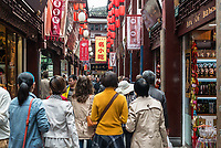 Shanghai, China - April 7, 2013: people walking in street of Fang Bang Zhong Lu at the old city of Shanghai in China on april 7th, 2013