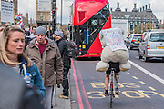Amputee, Gino Fiorellino, cycles around London with a bear on his back to support the doctors - The picket line at St Thomas' Hospital. Junior Doctors stage a 7 day all out strike action, this time imncluding accident and emergency coverage. They are striking against the new contracts due to be imposed by the Governemnt and health minister Jeremy Hunt. They are supported by the British Medical Association.