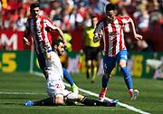 Burgui of Sporting Gijon is tackled by Nico Pareja of Sevilla FC during the Spanish championship Liga football match between Sevilla FC and Sporting Gijon on April 2, 2017 at Sanchez Pizjuan stadium in Sevilla, Spain - photo Cristobal Duenas / Spain / ProSportsImages / DPPI
