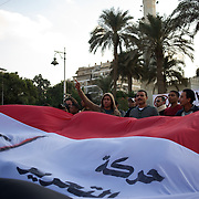 December 08, 2012 - Cairo, Egypt: Protestors anti-president Mohamed Morsi demonstrate in the streets near the presidential Palace in central Cairo...Sporadic clashes between supporters and opponents of president Mohamed Morsi, erupted in the past week over his assumption of extraordinary powers and the scheduling of a referendum on a disputed draft of the new constitution...Thousands of opposition protesters rallied outside the palace, in Cairo's Tahrir Square, and in cities and towns across the country, calling for an end to Mr Morsi's power grab and the shelving of the draft constitution. (Paulo Nunes dos Santos/Polaris)