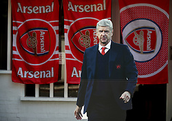 A cardboard cutout of Arsenal manager Arsene Wenger outside the ground before the Premier League match at the Emirates Stadium, London.