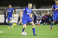 AFC Wimbledon midfielder Anthony Hartigan (26) dribbling during the EFL Trophy match between AFC Wimbledon and Tottenham Hotspur at the Cherry Red Records Stadium, Kingston, England on 3 October 2017. Photo by Matthew Redman.