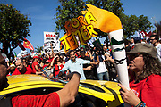 On the opening day of the Olympics, thousands took to the streets in multiple demonstrations. Here, in Copacabana, the relay torch route had to be re-routed because thousands of people with PT Workers Party banners and a variety of other organisations protested shouting Fora Temer Temer Out referring to the PMBD interim president.