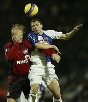 Photo: Aidan Ellis.<br /> Blackburn Rovers v Bayer Leverkusen. UEFA Cup, 2nd Leg. 22/02/2007.<br /> Rovers Stephen Warnock (R) wins the header with Bayer's Carsten Ramelow
