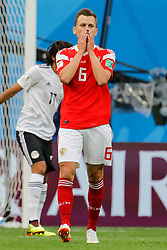 June 19, 2018 - Saint Petersburg, Russia - Denis Cheryshev (C) of Russia national team reacts after missing his chance during the 2018 FIFA World Cup Russia group A match between Russia and Egypt on June 19, 2018 at Saint Petersburg Stadium in Saint Petersburg, Russia. (Credit Image: © Mike Kireev/NurPhoto via ZUMA Press)