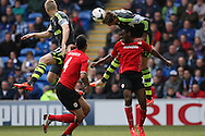 Peter Crouch of Stoke city climbs on Cardiff's Kevin Theophile-Catherine to win a header. Barclays Premier league match, Cardiff city  v Stoke city at the Cardiff city stadium in Cardiff, South Wales on Saturday 19th April 2014. pic by Mark Hawkins, Andrew Orchard sports photography,