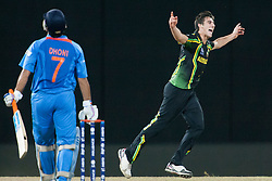 © Licensed to London News Pictures. 28/09/2012. Australian bowler Pat Cummins celebrates after getting the wicket of M.S Dhoni during the T20 Cricket World cup match between Australia Vs India at the R.Premadasa Cricket Stadium,Colombo. Photo credit : Asanka Brendon Ratnayake/LNP