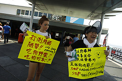 June 3, 2017 - Hong Kong, CHINA - Two female animal activists from Hong Kong and Germany call for stopping of Chinese dog-eating custom and the coming Dog-Eating Feast at Guang Xi Province China, annual YULIN GOUROW JIE ( Yulin Dog Meat Festival ) due to start from 21st of June. It is a global co-ordinated action to protest against annual Chinese Dog-Meat-Eating Festivity that aroused international outrage over the years since 2010.  It is said that Chinese provincial government at Guang Xi Province are set out to ban selling of all dog meats during the festivity from June 15 and onwards imposing maximum fine of 100,000 RMB to whom break the law. Higher awareness of animal protection is now spreading nation wide in recent years particularly among the young generation of animal-lovers in China which is gradually gaining momentum in voicing opinions on such habit as dog-eating in China. June 3, 2017. Hong Kong. ZUMA/Liau Chung Ren (Credit Image: © Liau Chung Ren via ZUMA Wire)